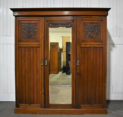 Antique Victorian triple carved walnut wardrobe
