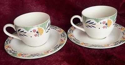 Two Poole Pottery Kimmeridge Cups And Saucers