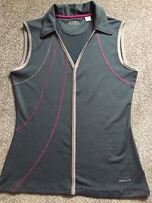 Ladies golf top by Annika. Worn once.  Size S.  Petrol grey, pink and silver.