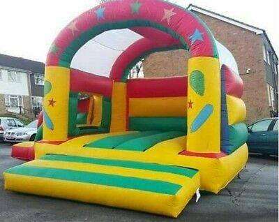 very large adult bouncy castle with slide