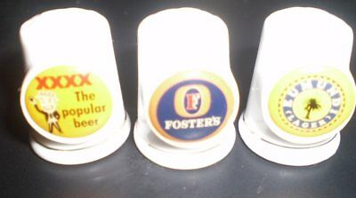 THREE Old crockery advertising thimbles  - Eumundi Lager,  XXXX,  Fosters Lager
