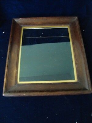 An Antique Carved Oak Picture Frame, Glazed.