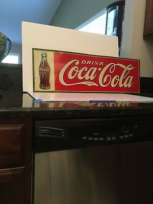 Coca Cola 1935 Metal Embossed Advertising Sign with 1923 Christmas Bottle