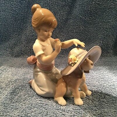 """Lladro """"an Elegant Touch"""" #6862 Girl Putting Dog In Hat Mint In Original Box."""