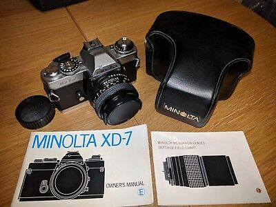 Minolta XD7 film camera with 50mm lens and leather case
