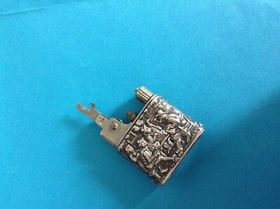 Antique Baby-mylflam silver embossed lighter