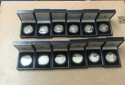 Hong Kong CHINESE ZODIAC SILVER PROOF MEDALLIONS. 12 MEDALLIONS & BOOKLET.