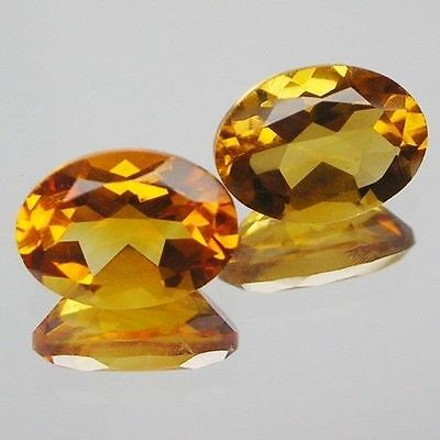 A PAIR OF 6x4mm OVAL-FACET NATURAL AFRICAN GOLDEN CITRINE GEMSTONES