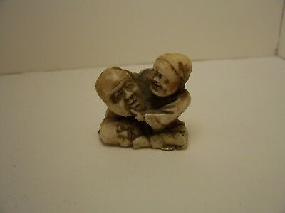 Plastic Netsuke Man With Mask