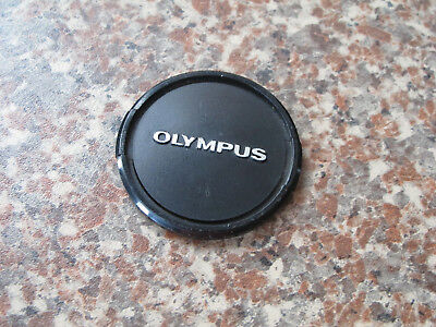 49mm and 55mm Olympus lens caps.