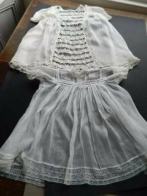 Two antique Edwardian white  baby or doll's dresses. Lots of lace