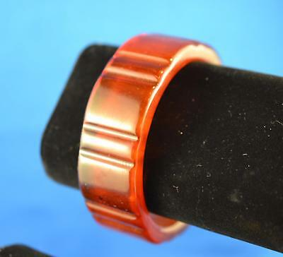 VINTAGE BROWNISH ORANGE BAKELITE THICK BRACELET. 50.6g WEIGHT. 3 INCH DIAMETER.