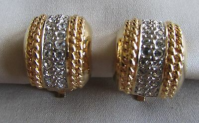 Vintage gold tone clip on Butler earrings with rhinestones