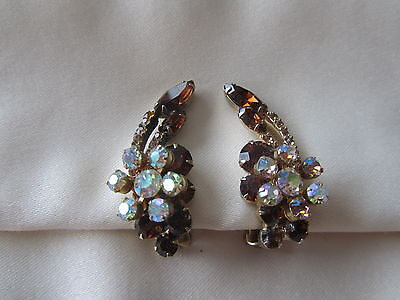 Vintage gold tone stardust clip on earrings with brown and yellow rhinestones