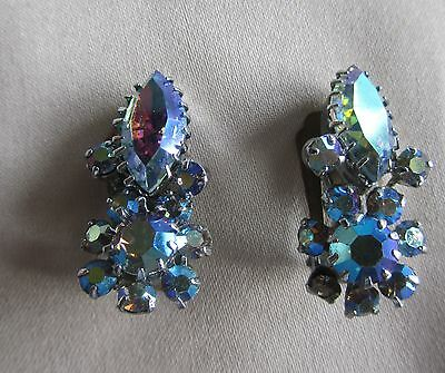 Vintage silver tone clip on flower earrings with blue AB rhinestones