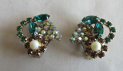 Vintage gold tone clip on flower earrings with green and brown rhinestones