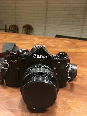 Canon A-1 35mm SLR - Canon FD 50 mm 1.2 + FD 20 mm 2.8 other lenses and extras