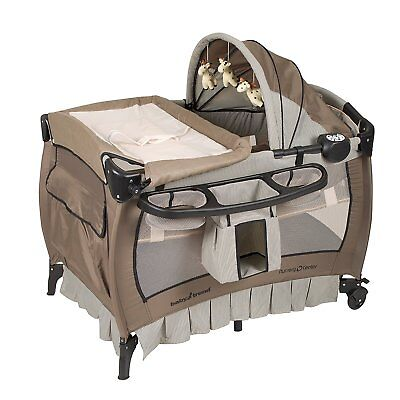 Baby Trend Deluxe Nursery Center, Pack N Play Bassinet with Canopy - Haven Wood