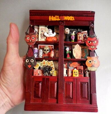 dollhouse miniature halloween cabinet filled with goodies