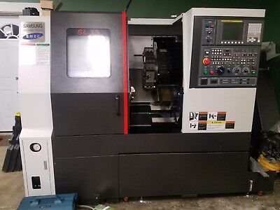 2016 Samsung SL15 CNC Lathe w/ Chip Conveyor. NEVER USED. 5 HOURS ON IT.