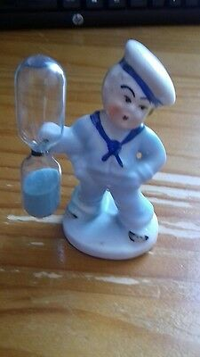 Vintage Sailor Boy egg timer with glass marked Germany on base