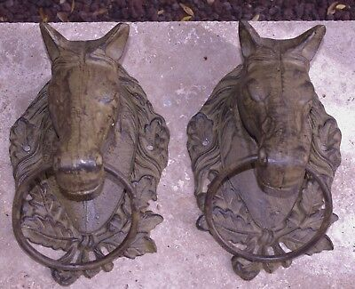 "A Pair Of Ex Large Wall Mount Cast Iron Horse Heads With Hitching Ring.11"" Tall"