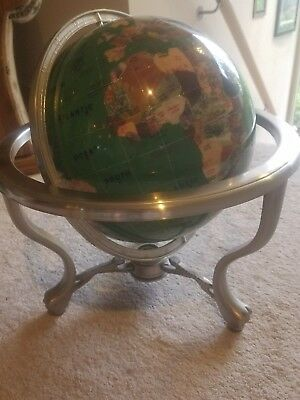 World Globe With Compass On A Metal Stand