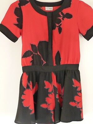 Girls playsuit by Next with red and black print. Age 10 years. VGC.