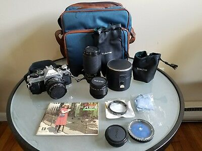 canon ae-1 35mm slr film camera, 50mm f/1.8, tokina 80-200 f/3.5, tested.