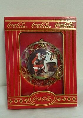 Coca Cola porcelain in gold inlay Christmas Ornament Santa at the hearth