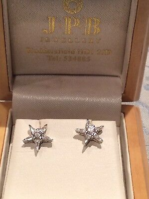 18ct white gold and diamond star shaped earrings.