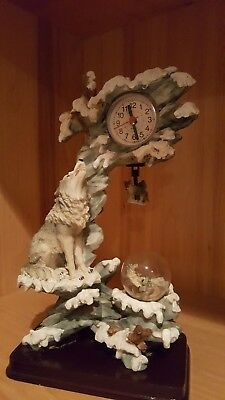 Wolf clock with small moving hanging wolf