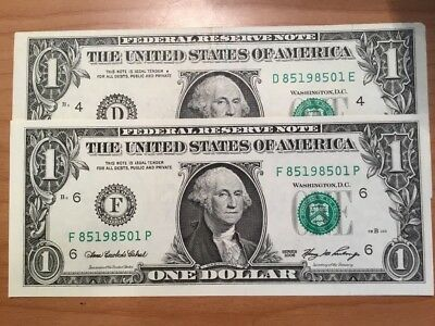 2 X US one dollar notes with matching serial numbers.