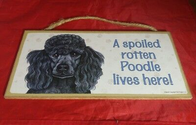 A spoiled rotten poodle lives here wooden sign