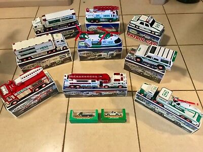 Large Lot of Hess Collectible Trucks Police Fire Helicopter & More in Boxes EUC