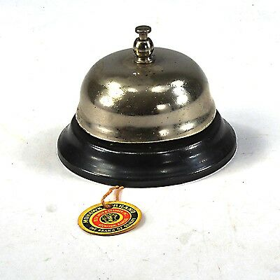 Antique tap action desk bell with embossed patent date of 1887 on its iron base,
