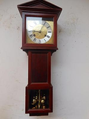 intresting hermle ting tang wall clock with 400 day pendulumn to base