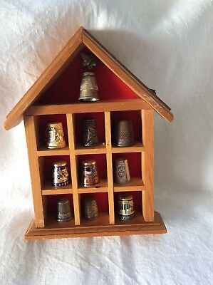 A Collection 10  metal thimbles in small display box