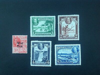 British Guiana George V five mounted mint stamps.