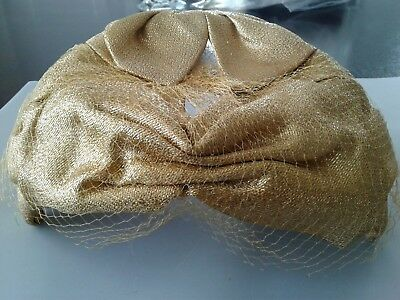 1950's  vintage woman's gold hat with veil