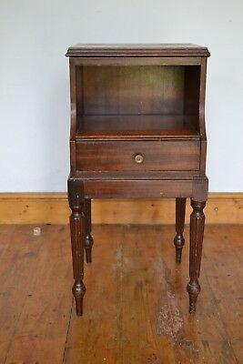 An antique bedside cabinet