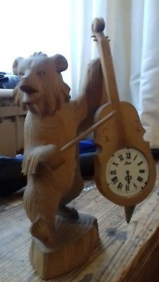 black forest ?wooden carved bear with clock