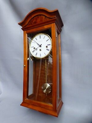 A Super Quality Mahogany And Walnut Cased Westminster Chime Comitti Wall Clock