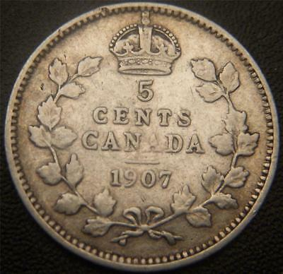 1907 Canadian Silver Dollar - Partial Ear and Bands of Crown Still Show