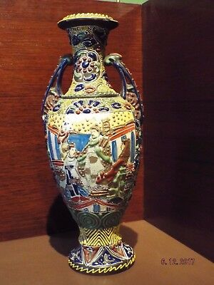 A MEIJI PERIOD SATSUMA TWO HANDLED VASE WITH RAISED DECORATION, 30cm TALL.#1