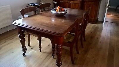 Mahogany dining table - with extension leaf, extending
