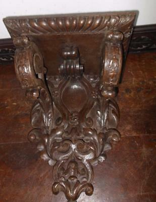 nicely carved clock /. wall bracket