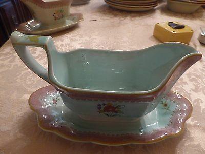 Adams Calyx Ware member of the Wedgewood group gravy boat with attached plate