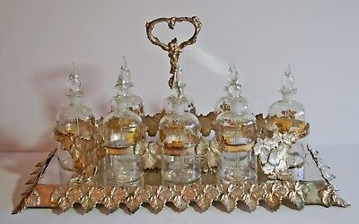 Vintage 8 bottle perfume cruet with plated ornate grape & vine stand - French?