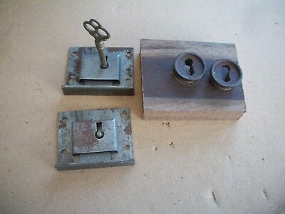pair of Victorian bookcase door locks with key and Walnut escutcheons, drawer